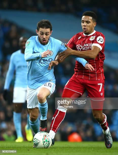 Bernardo Silva of Manchester City and Korey Smith of Bristol City battle for the ball during the Carabao Cup SemiFinal First Leg match between...