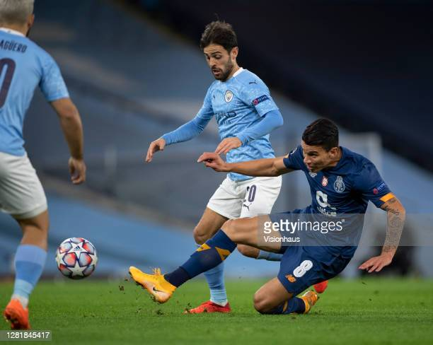 Bernardo Silva of Manchester City and Matheus Uribe of FC Porto in action during the UEFA Champions League Group C stage match between Manchester...