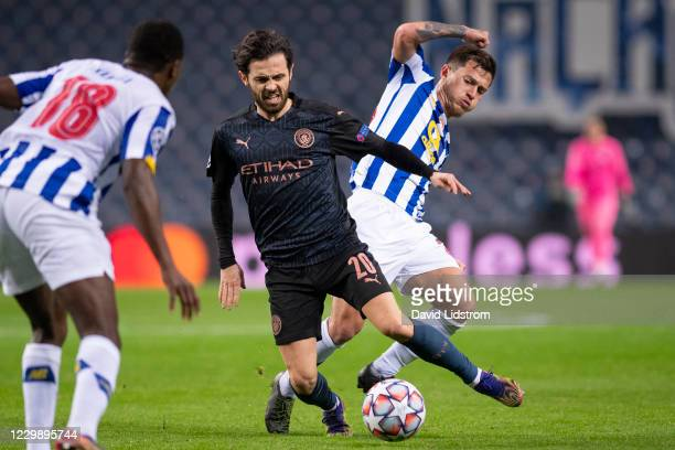 Bernardo Silva of Manchester City and Otavio of FC Porto battle for the ball during the UEFA Champions League Group C stage match between FC Porto...
