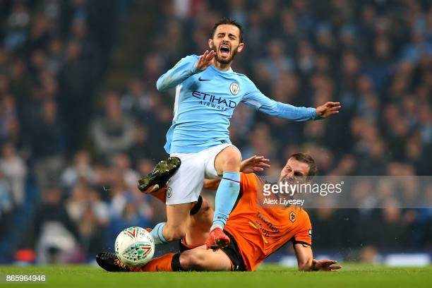 Bernardo Silva of Manchester City and Ryan Bennett of Wolverhampton Wanderers clash during the Carabao Cup Fourth Round match between Manchester City...