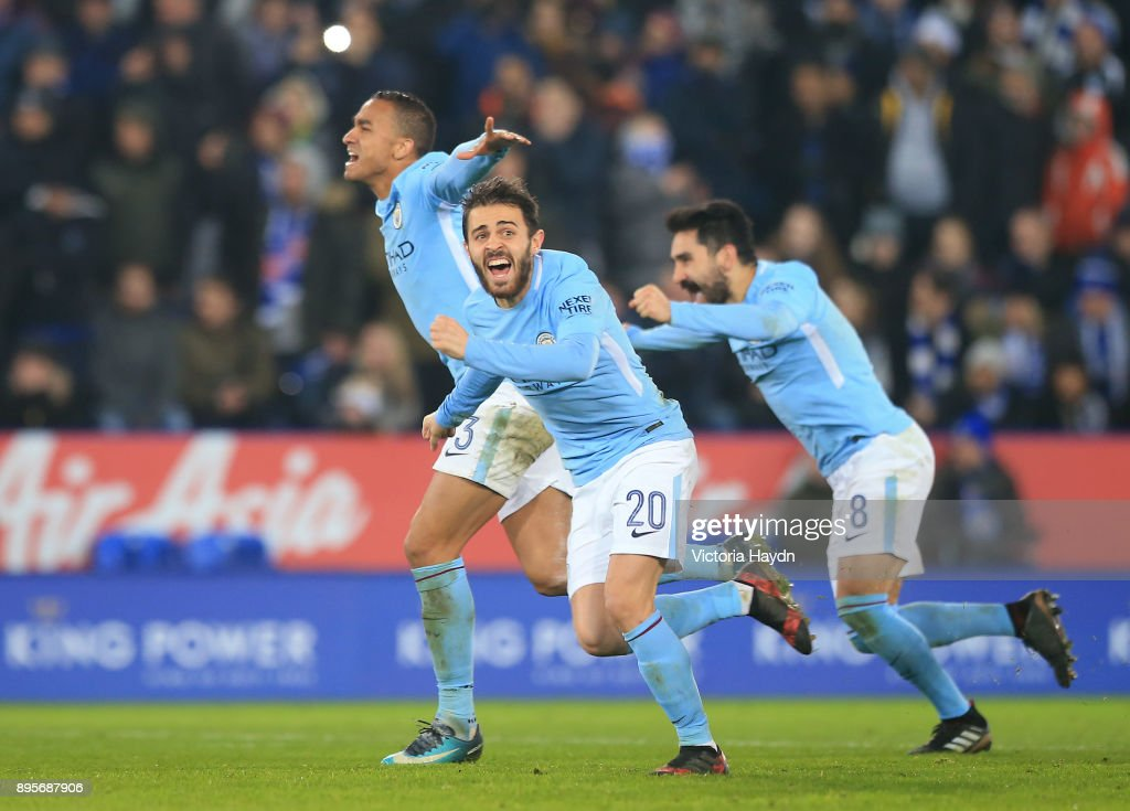 Bernardo Silva of Manchester City (20) and team mates celebrate penalty shoot out victory during the Carabao Cup Quarter-Final match between Leicester City and Manchester City at The King Power Stadium on December 19, 2017 in Leicester, England.