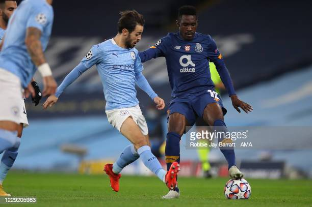 Bernardo Silva of Manchester City and Zaidu Sanusi of FC Porto during the UEFA Champions League Group C stage match between Manchester City and FC...