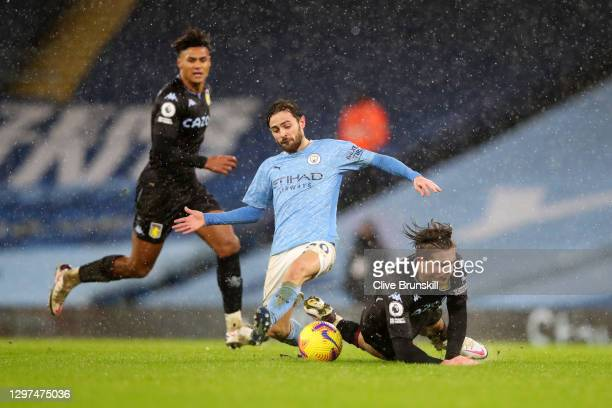 Bernardo Silva of Manchester City battles for possession with Jack Grealish of Aston Villa during the Premier League match between Manchester City...