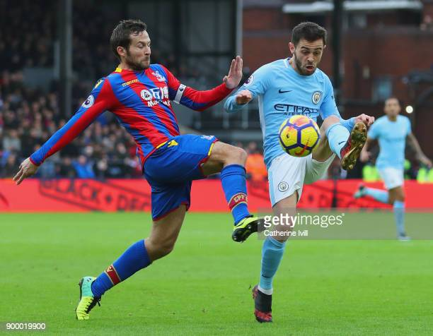 Bernardo Silva of Manchester City battles with Yohan Cabaye of Crystal Palace during the Premier League match between Crystal Palace and Manchester...