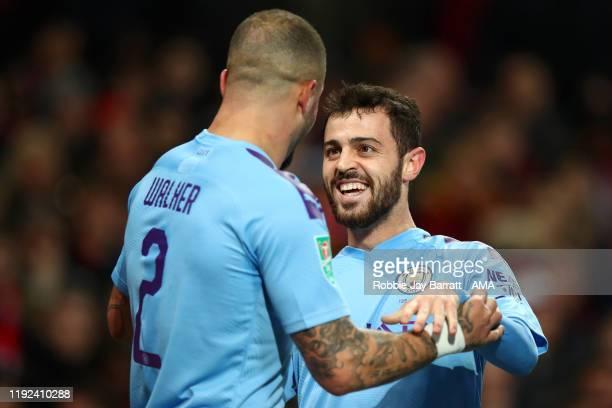 Bernardo Silva of Manchester City celebrates after scoring a goal to make it 0-1 with Kyle Walker during the Carabao Cup Semi Final match between...