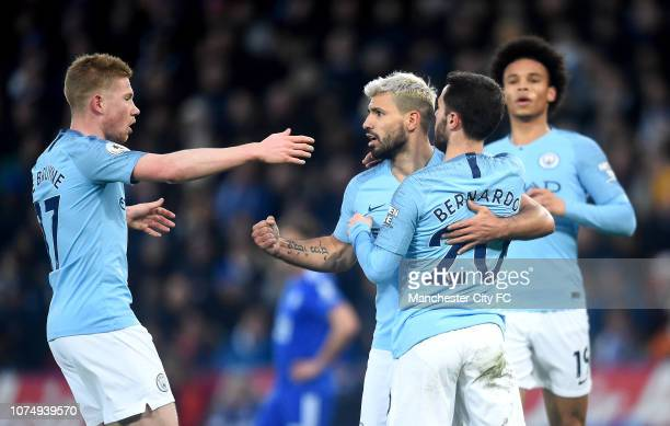 Bernardo Silva of Manchester City celebrates after scoring his team's first goal with Sergio Aguero of Manchester City and Kevin De Bruyne of...