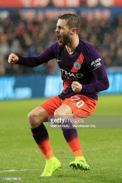 Bernardo Silva of Manchester City celebrates after scoring his team's first goal during the FA Cup Quarter Final match between Swansea City and...