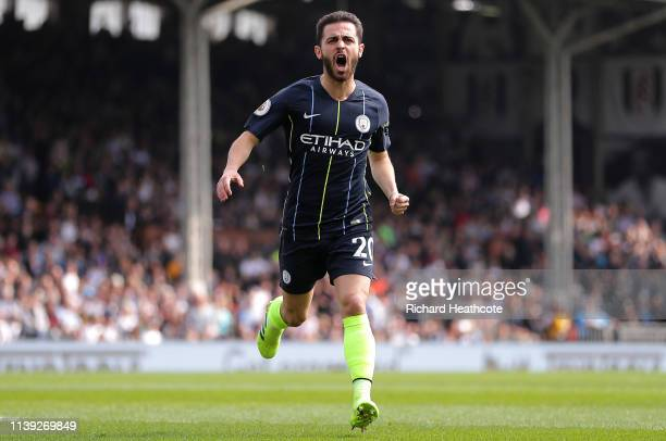 Bernardo Silva of Manchester City celebrates after scoring his team's first goal during the Premier League match between Fulham FC and Manchester...