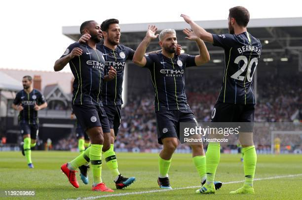 Bernardo Silva of Manchester City celebrates after scoring his team's first goal with her team mates during the Premier League match between Fulham...