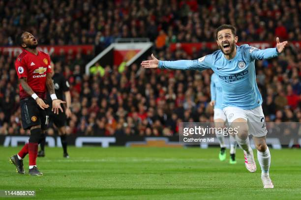 Bernardo Silva of Manchester City celebrates after scoring his team's first goal as Fred of Manchester United reacts during the Premier League match...
