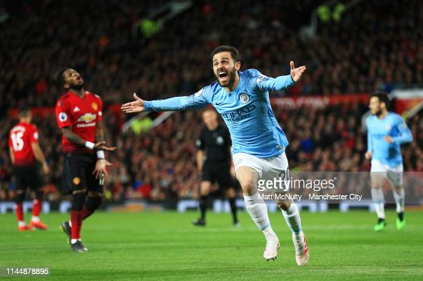 Bernardo Silva of Manchester City celebrates after scoring his teams first goal during the Premier League match between Manchester United and...