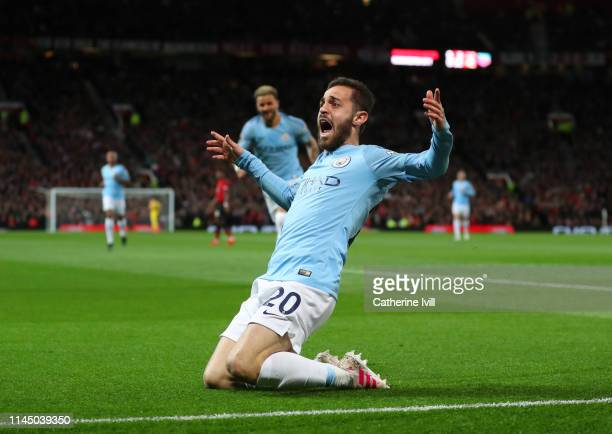 Bernardo Silva of Manchester City celebrates after scoring his team's first goal during the Premier League match between Manchester United and...