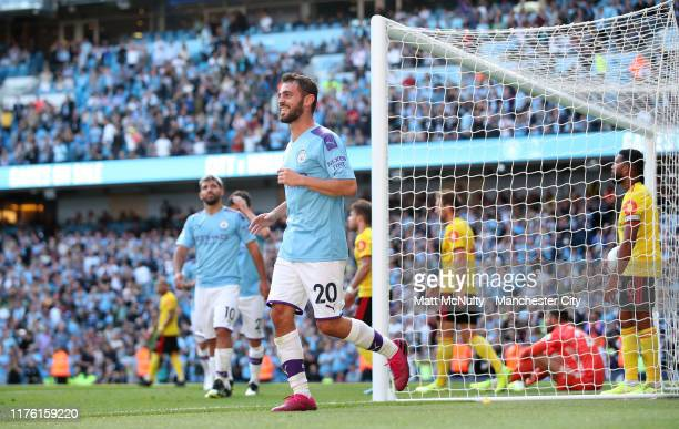 Bernardo Silva of Manchester City celebrates after scoring his team's seventh goal and completes his hat trick during the Premier League match...
