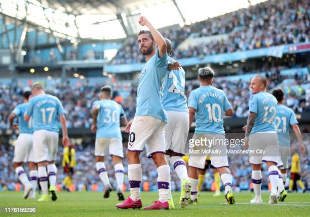 Bernardo Silva of Manchester City celebrates after scoring his team's seventh goal and completes his hat trick with team mates during the Premier...