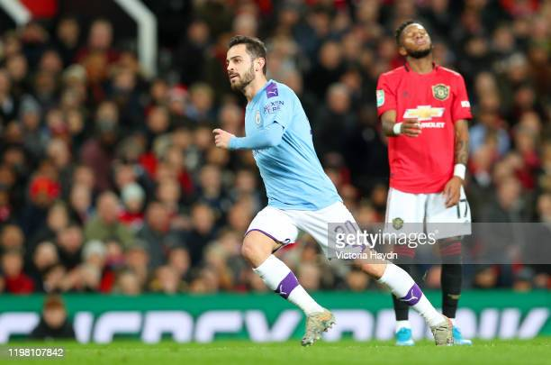 Bernardo Silva of Manchester City celebrates after scoring his team's first goal as Fred of Manchester United reacts during the Carabao Cup Semi...