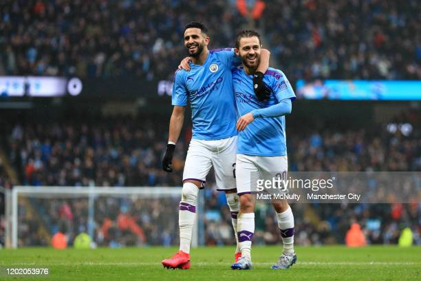 Bernardo Silva of Manchester City celebrates after scoring his team's second goal with Riyad Mahrez during the FA Cup Fourth Round match between...