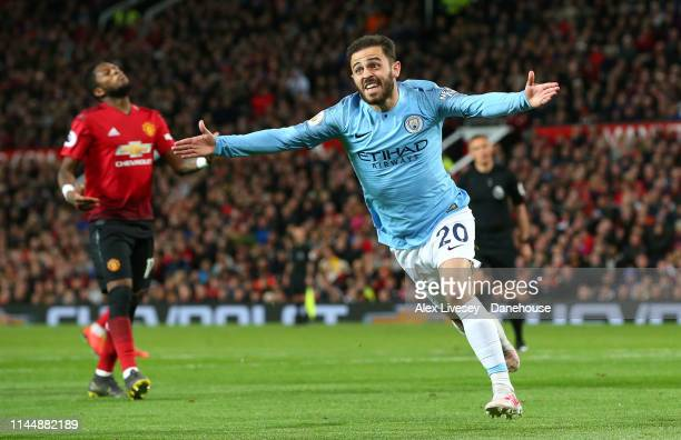 Bernardo Silva of Manchester City celebrates after scoring the opening goal during the Premier League match between Manchester United and Manchester...