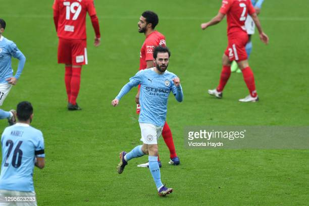 Bernardo Silva of Manchester City celebrates after scoring their side's first goal during the FA Cup Third Round match between Manchester City and...