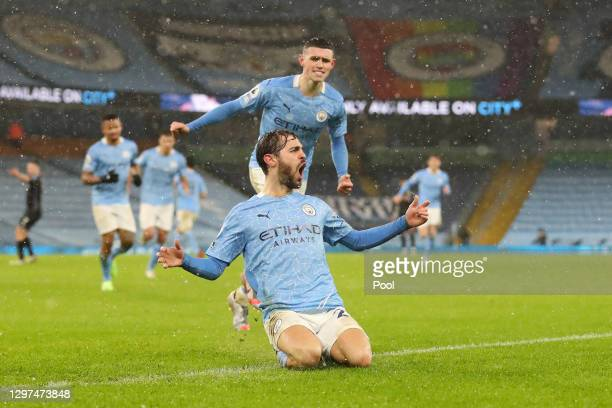 Bernardo Silva of Manchester City celebrates after scoring their side's first goal during the Premier League match between Manchester City and Aston...