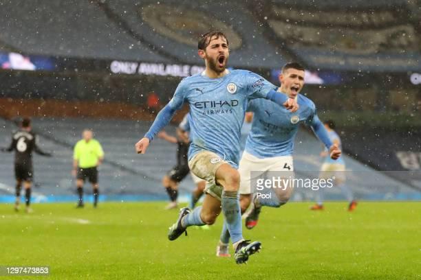 Bernardo Silva of Manchester City celebrates after scoring their team's first goal during the Premier League match between Manchester City and Aston...