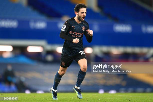 Bernardo Silva of Manchester City celebrates after scoring their side's third goal during the Premier League match between Everton and Manchester...