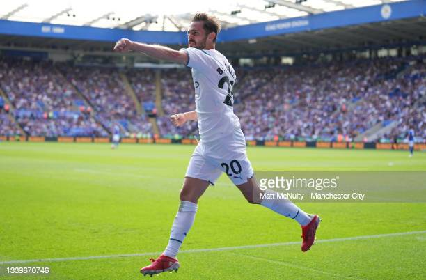 Bernardo Silva of Manchester City celebrates after scoring their side's fist goal during the Premier League match between Leicester City and...
