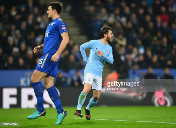 Bernardo Silva of Manchester City celebrates as he scores their first goal as Harry Maguire of Leicester City looks dejected during the Carabao Cup...