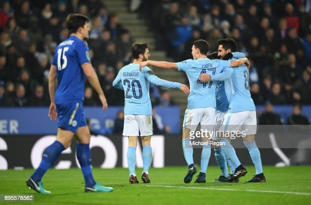 Bernardo Silva of Manchester City celebrates as he scores their first goal with team mates during the Carabao Cup QuarterFinal match between...
