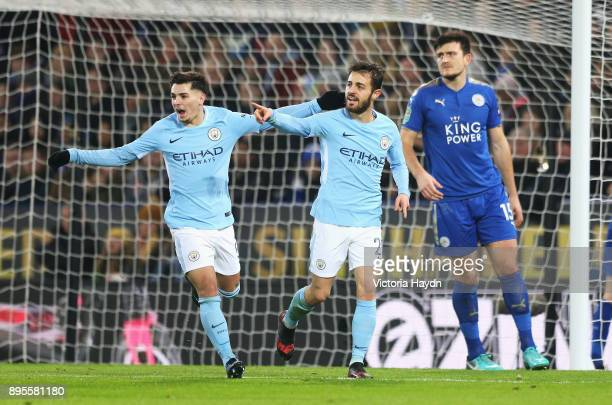 Bernardo Silva of Manchester City celebrates as he scores their first goal with team mate Brahim Diaz during the Carabao Cup QuarterFinal match...
