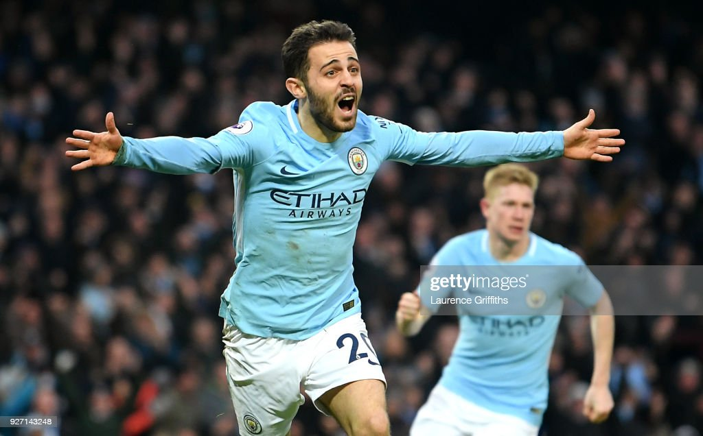 Bernardo Silva of Manchester City celebrates scoring his side's first goal during the Premier League match between Manchester City and Chelsea at Etihad Stadium on March 4, 2018 in Manchester, England.