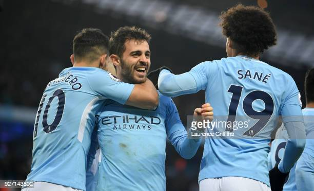 Bernardo Silva of Manchester City celebrates scoring his side's first goal with Sergio Aguero and Leroy Sane during the Premier League match between...