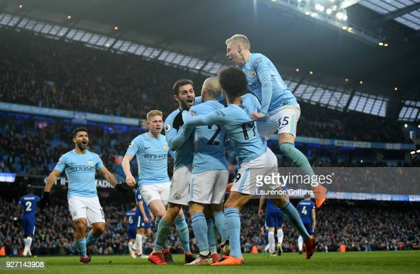 Bernardo Silva of Manchester City celebrates scoring his side's first goal with team mates during the Premier League match between Manchester City...