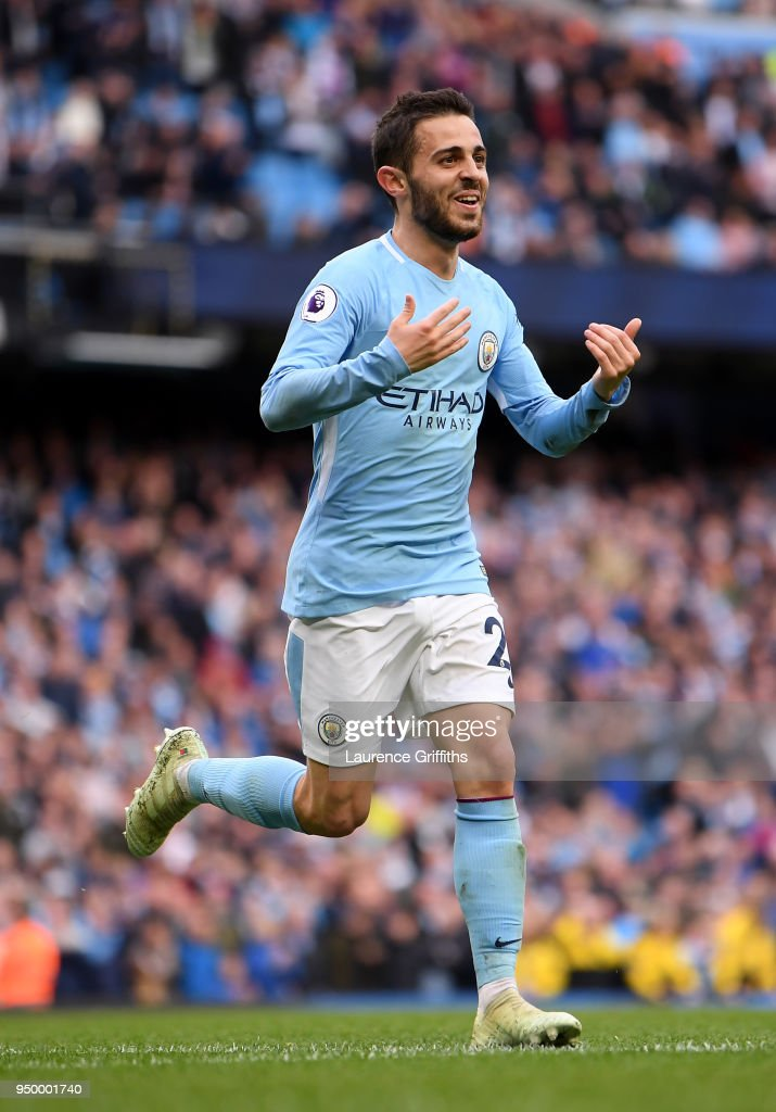 Bernardo Silva of Manchester City celebrates scoring his side's fourth goal during the Premier League match between Manchester City and Swansea City at Etihad Stadium on April 22, 2018 in Manchester, England.