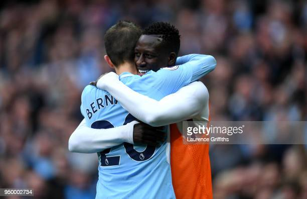Bernardo Silva of Manchester City celebrates scoring his side's fourth goal with Benjamin Mendy during the Premier League match between Manchester...