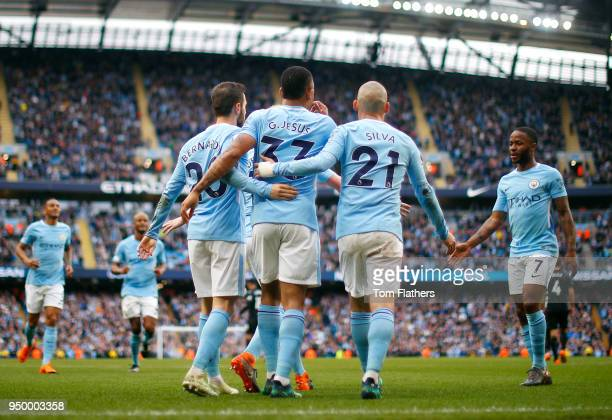 Bernardo Silva of Manchester City celebrates scoring his side's fourth goal with Gabriel Jesus and David Silva during the Premier League match...