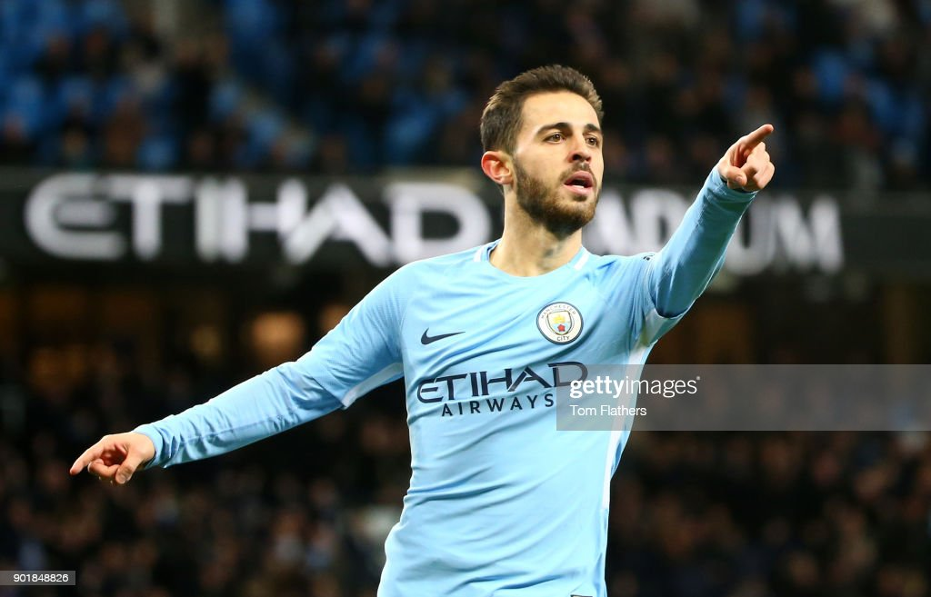 Bernardo Silva of Manchester City celebrates scoring his team's fourth goal during The Emirates FA Cup Third Round match between Manchester City and Burnley at Etihad Stadium on January 6, 2018 in Manchester, England.