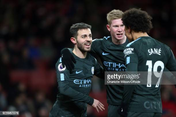 Bernardo Silva of Manchester City celebrates scoring the opening goal with Kevin De Bruyne and Leroy Sane during the Premier League match between...