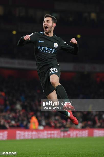 Bernardo Silva of Manchester City celebrates scoring the opening goal during the Premier League match between Arsenal and Manchester City at Emirates...