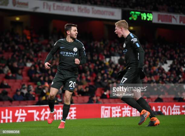 Bernardo Silva of Manchester City celebrates scoring the opening goal with Kevin De Bruyne during the Premier League match between Arsenal and...