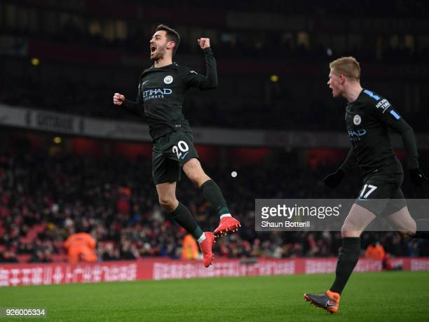 Bernardo Silva of Manchester City celebrates scoring the opening goal as Kevin De Bruyne looks on during the Premier League match between Arsenal and...