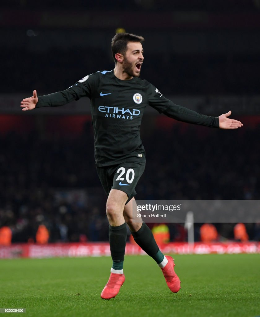 Bernardo Silva of Manchester City celebrates scoring the opening goal during the Premier League match between Arsenal and Manchester City at Emirates Stadium on March 1, 2018 in London, England.