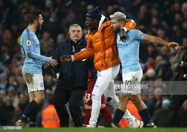 Bernardo Silva of Manchester City celebrates victory with Benjamin Mendy of Manchester City and Sergio Aguero of Manchester City after the Premier...