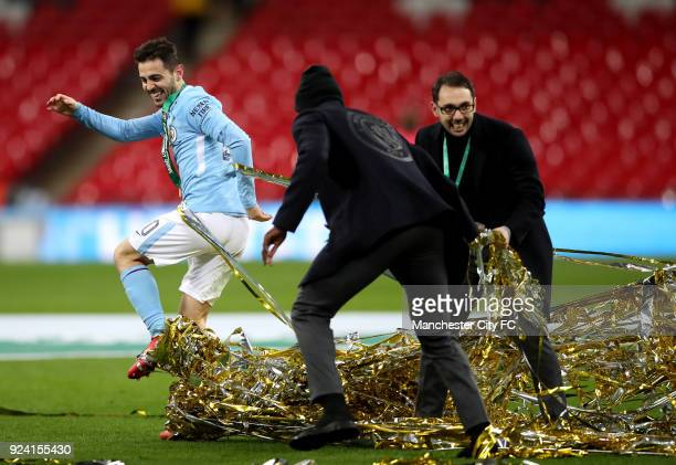 Bernardo Silva of Manchester City celebrates with Benjamin Mendy of Manchester City after winning the Carabao Cup Final between the Arsenal and...