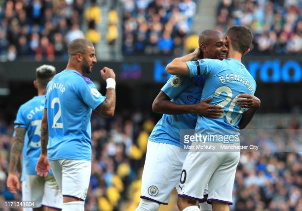 Bernardo Silva of Manchester City celebrates with Fernandinho of Manchester City after scoring their team's fourth goal during the Premier League...