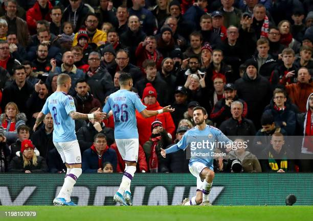 Bernardo Silva of Manchester City celebrates with Kyle Walker and Riyad Mahrez after scoring his team's first goal during the Carabao Cup Semi Final...