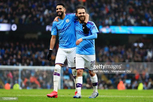 Bernardo Silva of Manchester City celebrates with Riyad Mahrez after scoring his teams second goal during the FA Cup Fourth Round match between...