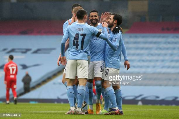 Bernardo Silva of Manchester City celebrates with Riyad Mahrez and team mates after scoring their side's second goal during the FA Cup Third Round...