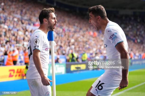 Bernardo Silva of Manchester City celebrates with Rodrigo after scoring their side's fist goal during the Premier League match between Leicester City...