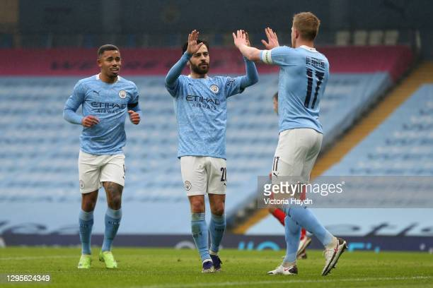 Bernardo Silva of Manchester City celebrates with team mates Gabriel Jesus and Kevin De Bruyne after scoring their side's second goal during the FA...