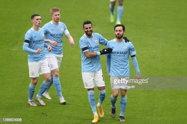 Bernardo Silva of Manchester City celebrates with team mates Phil Foden, Kevin De Bruyne and Riyad Mahrez after scoring their side's first goal...
